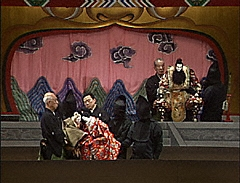 Bunraku Puppet Theater Performance with Master Puppeteer Onstage Manipulating the Puppet