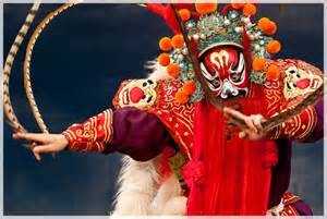 Chinese Peking Opera Player in Traditional Mask and Costume